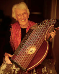 Ilse holding a Zither
